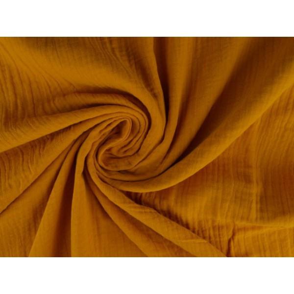 Mousseline stof okergeel - Katoenen stof op rol